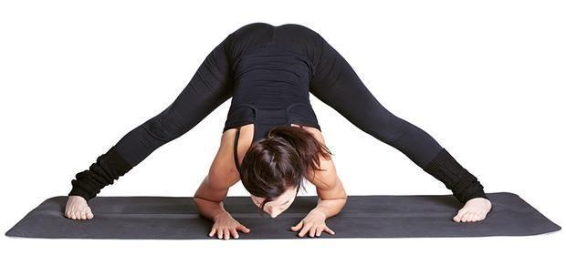 Wide legged forward fold yoga posture